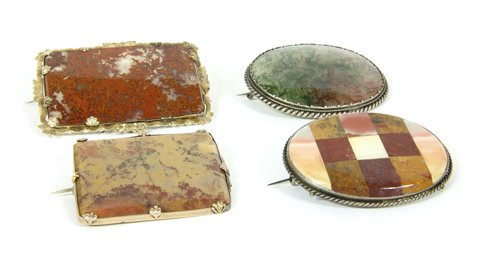 Lot 14-Four Victorian agate brooches, comprising a...
