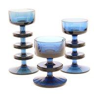 Lot 239 - A set of three blue glass Sheringham candleholders, designed by Ronald Stennett-Wilson for Wedgwood