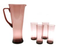 Lot 398 - An amethyst glass lemonade set, consisting of a jug, and four tumblers, by Whitefriars, British, c.1960