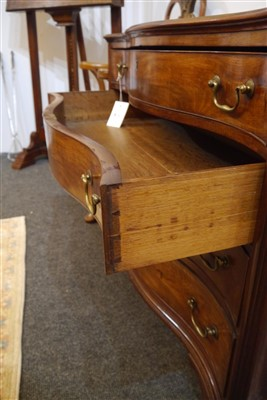Lot 655-A George III mahogany serpentine commode chest