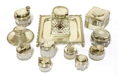 Lot 49-Eleven silver-mounted glass inkwells