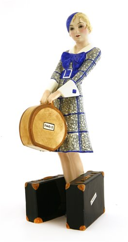 Lot 80-A Goldscheider figure of a woman holding a hat box, holding two suitcases