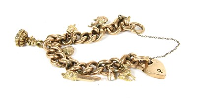 Lot 18-A 9ct gold hollow curb chain charm bracelet