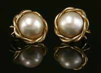 Lot 24-A pair of 9ct gold mabe pearl earrings