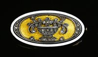 Lot 53-An Austrian gold, silver and enamel oval, giardinetti plaque brooch