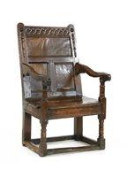 Lot 535-An oak panel back open armchair