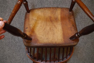 Lot 512-An harlequin set of five early Victorian yew wood and elm Windsor chairs
