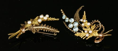 Lot 233 - A 9ct two colour gold blue zircon and cultured pearl fern spray brooch