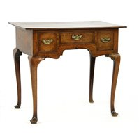 Lot 502-An oak and crossbanded lowboy