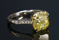 Lot 538 - A yellow and white gold single stone fancy vivid yellow diamond ring