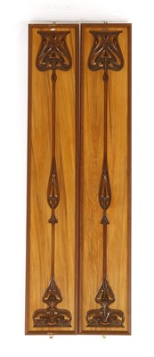 Lot 18-A pair of carved rosewood Secessionist wall panels