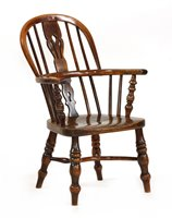 Lot 527-A yew wood and elm child's Windsor chair
