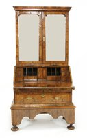 Lot 505-A walnut, feather-banded and fruitwood bureau cabinet on stand