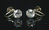 Lot 57-A pair of single stone diamond stud earrings