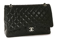 Lot 742 - A Chanel classic single flap black leather maxi handbag