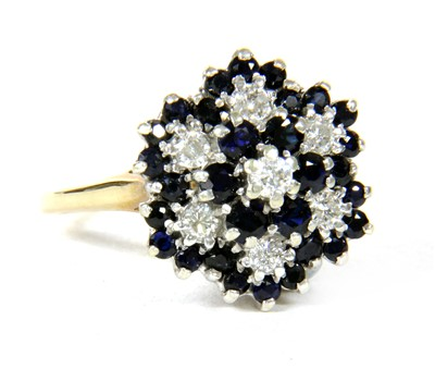 Lot 11-A 9ct gold diamond and sapphire four tier cluster ring