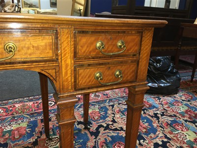 Lot 305-An Howard & Sons satinwood writing table