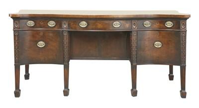 Lot 43-A George III-style serpentine mahogany sideboard