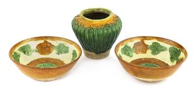 Lot 334 - A pair of Chinese sancai bowls