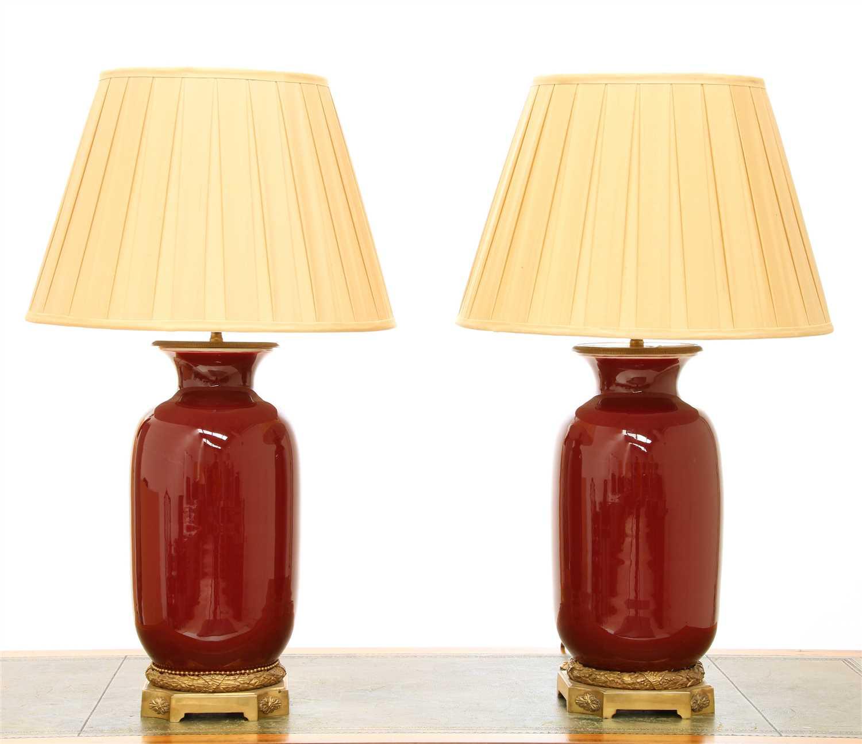 Lot 44 - Two similar modern sang-de-boeuf vase table lamps
