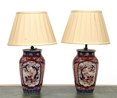 Lot 204 - A pair of Imari vase table lamps