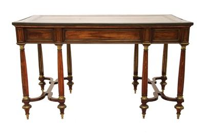 Lot 289 - A Louis XVI-style mahogany bureau plat