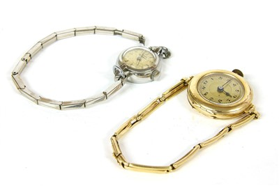 Lot 6-A ladies stainless steel Giraud Peregaux mechanical cordette strap watch