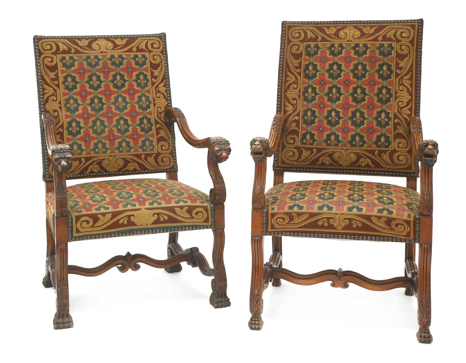 Lot 4-A pair of French walnut elbow chairs