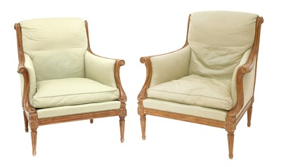 Lot 110 - A pair of French upholstered library chairs