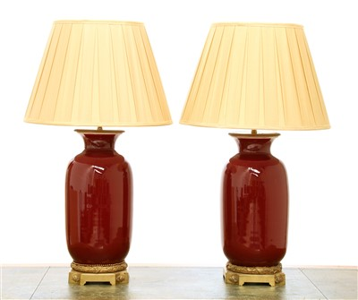 Lot 57 - A pair of modern sang-de-boeuf vase table lamps
