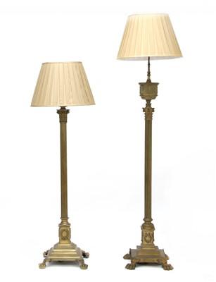 Lot 128 - Two brass standard lamps