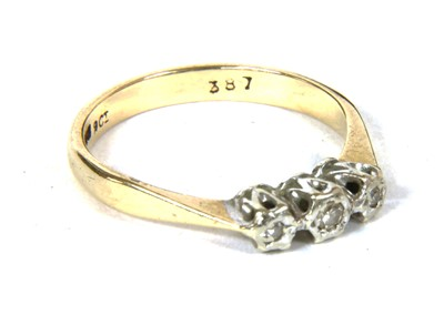 Lot 17-A 9ct gold three stone diamond ring
