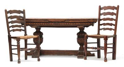 Lot 179 - An oak draw-leaf dining table