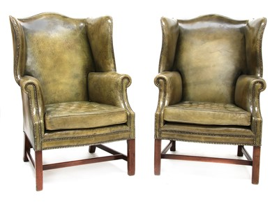 Lot 105 - A pair of George III-style wing armchairs