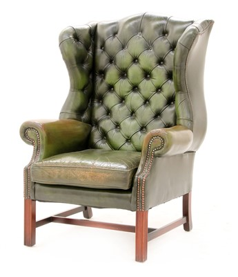 Lot 113 - A George III-style wing armchair
