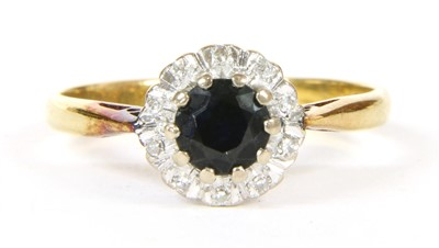 Lot 16A-A sapphire and diamond cluster ring