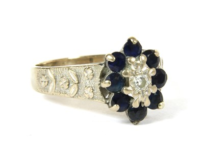 Lot 2B-An 18ct white gold diamond and sapphire oval cluster ring
