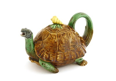 Lot 161 - A Minton Majolica tortoise teapot and cover