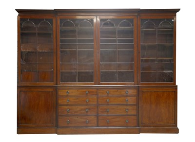 Lot 130 - A George III-style mahogany breakfront bookcase