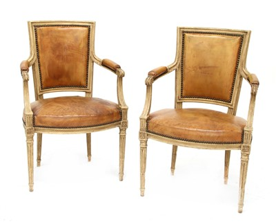 Lot 38-A pair of Louis XVI-style elbow chairs