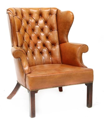 Lot 126 - A wing armchair