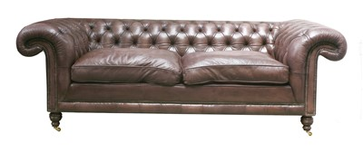 Lot 131 - A modern leather three-seater chesterfield settee