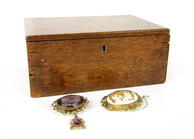 Lot 3-A Victorian rolled gold amethyst brooch with drop pendant