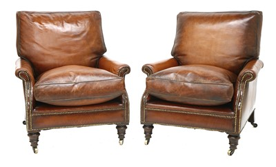 Lot 164 - A pair of brown leather armchairs