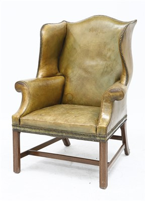 Lot 133 - A George III-style green leather wing armchair