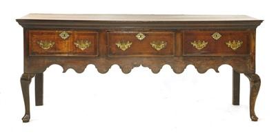 Lot 531-A George II oak and walnut low dresser