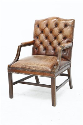 Lot 147 - A brown leather office chair