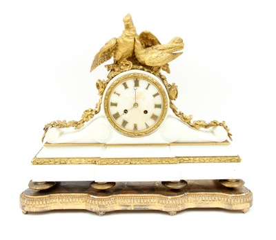 Lot 32-A French alabaster and ormolu mantel clock