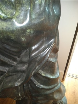 Lot 22-A pair of life-sized green patinated bronze blackamoors