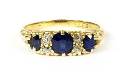 Lot 9-A three stone sapphire ring